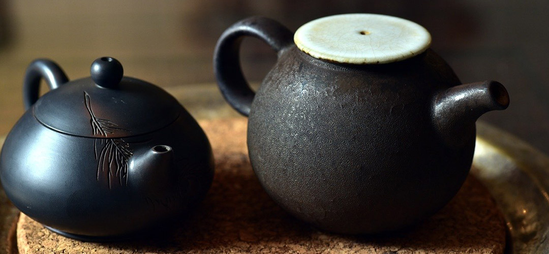 Two chinese style teapots. It's a calm and tranquil scene